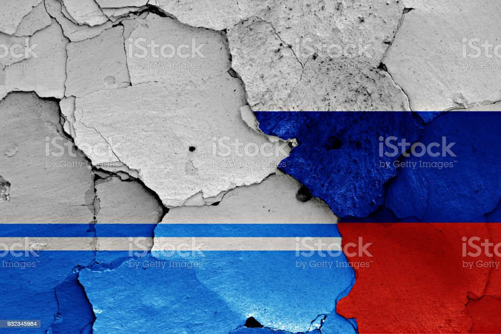 flag of Altai republic and Russia painted on cracked wall stock photo