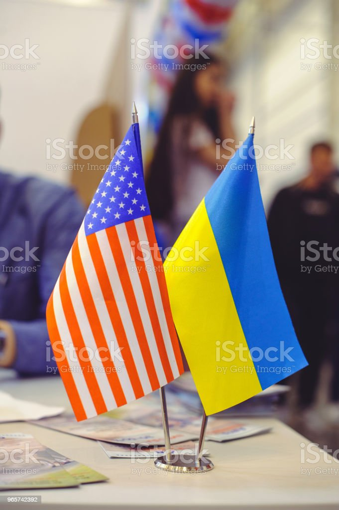 flag of America and Ukraine on the table, business relations between countries - Royalty-free Agreement Stock Photo
