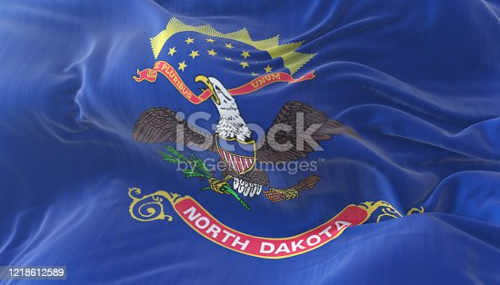 Flag of american state of North Dakota, region of the United States, waving at wind