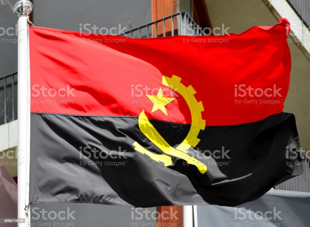 Flag of Angola in the wind (photograph, not computer generated) stock photo