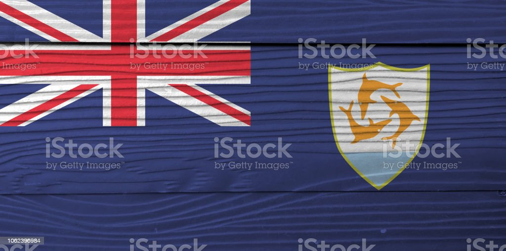 Flag of Anguilla on wooden wall background. Grunge Anguilla flag texture. stock photo