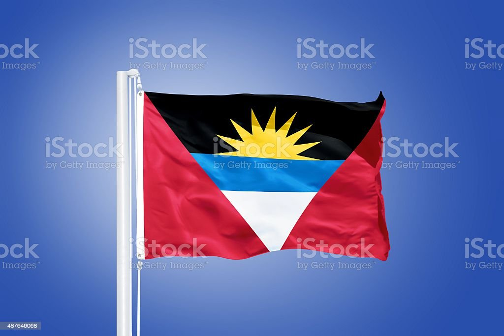Flag of Antigua and Barbuda flying against a blue sky stock photo