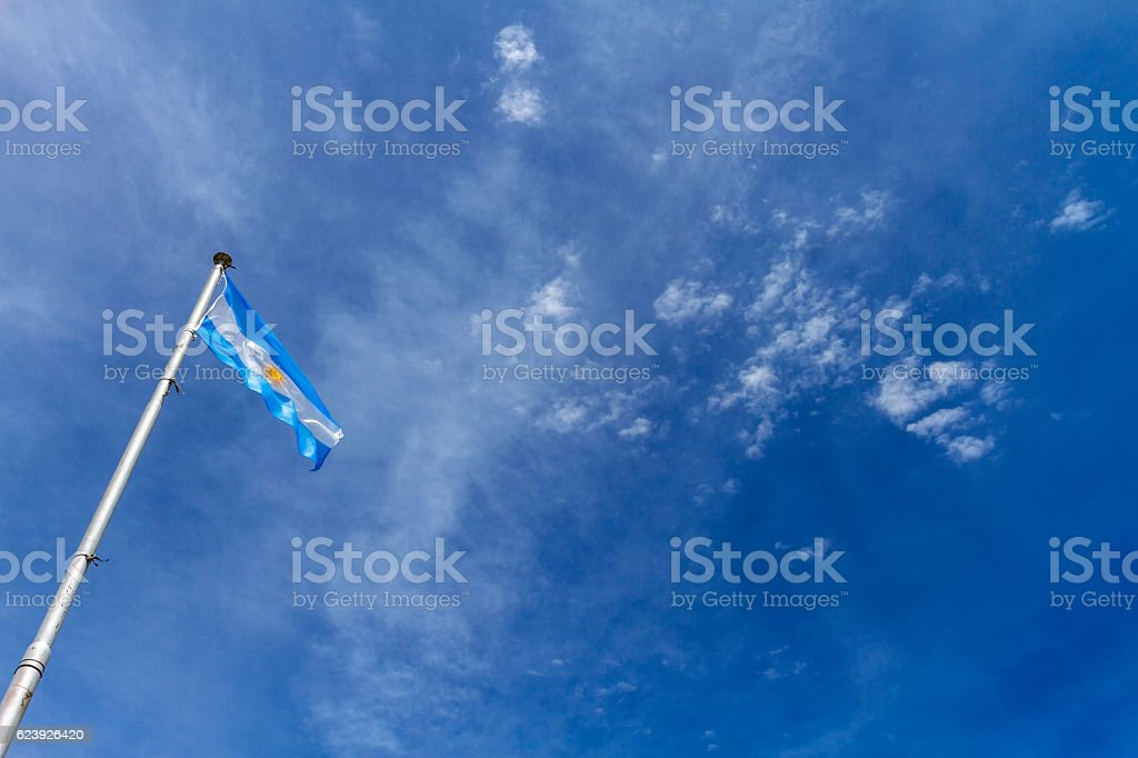 Flag of Argentina flaming against blue sky at Buenos Aires stock photo