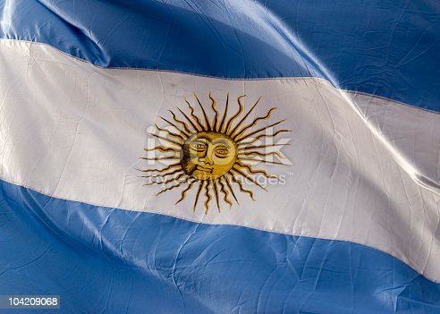 A large flag of of Argentina captured at the legendary Plaza de Mayo. This is a real flag, under real circumstances in open space and with daylight.