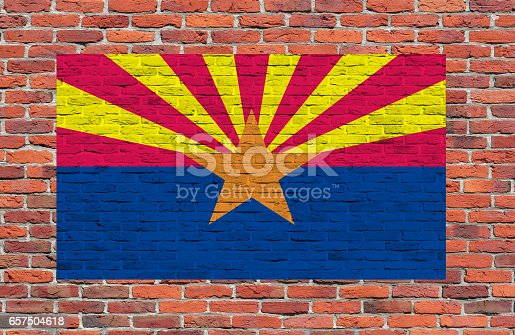 Flag of Arizona State painted over brick wall