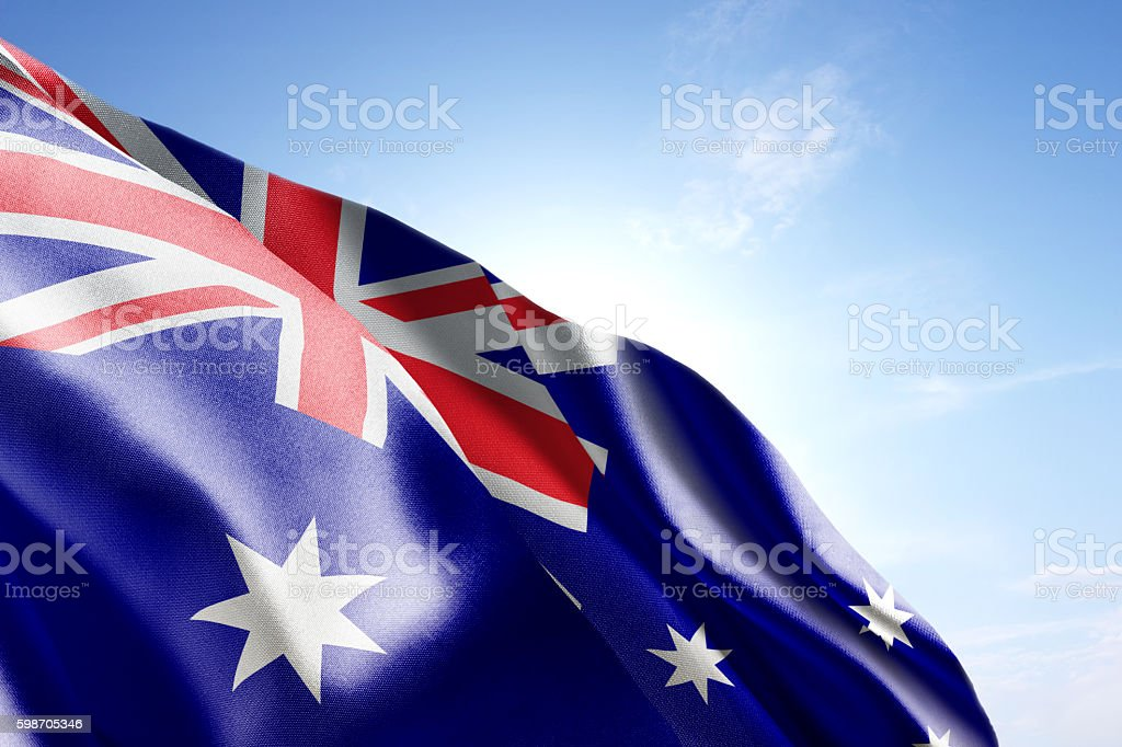 Flag of Australia waving in the wind stock photo