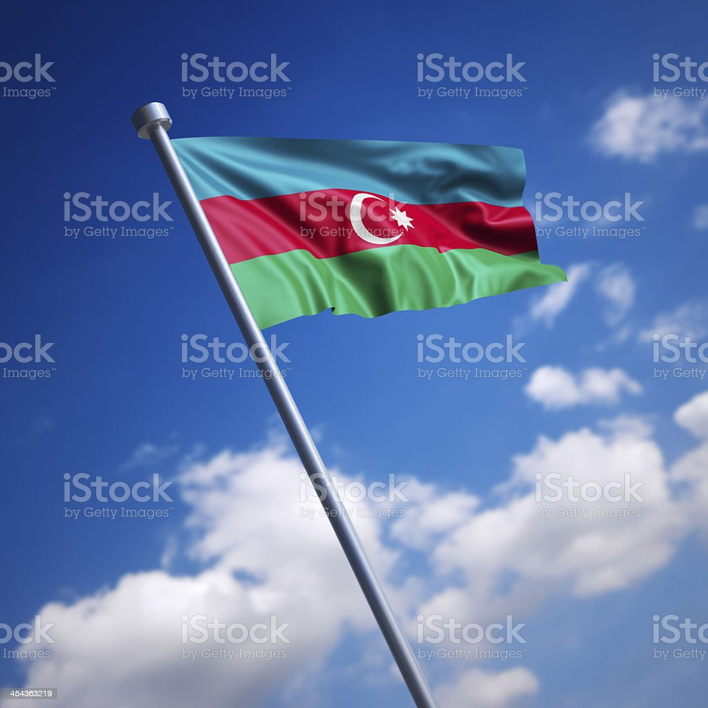Flag of Azerbaijan against blue sky stock photo