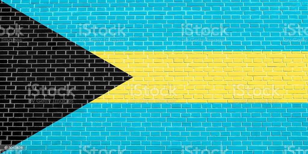 Flag of Bahamas on brick wall texture background stock photo
