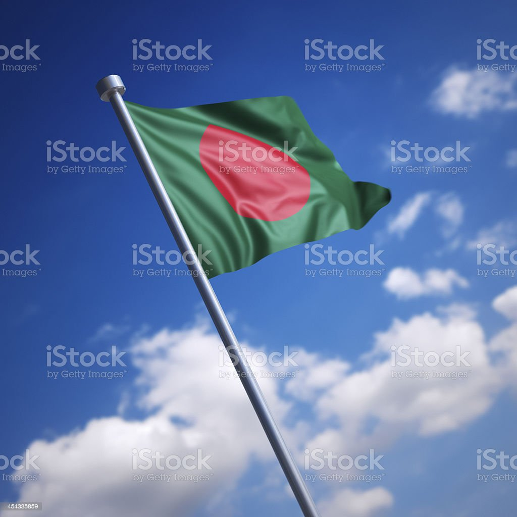 Flag of Bangladesh against blue sky stock photo