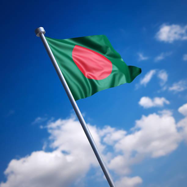 Flag of Bangladesh against blue sky stock photo