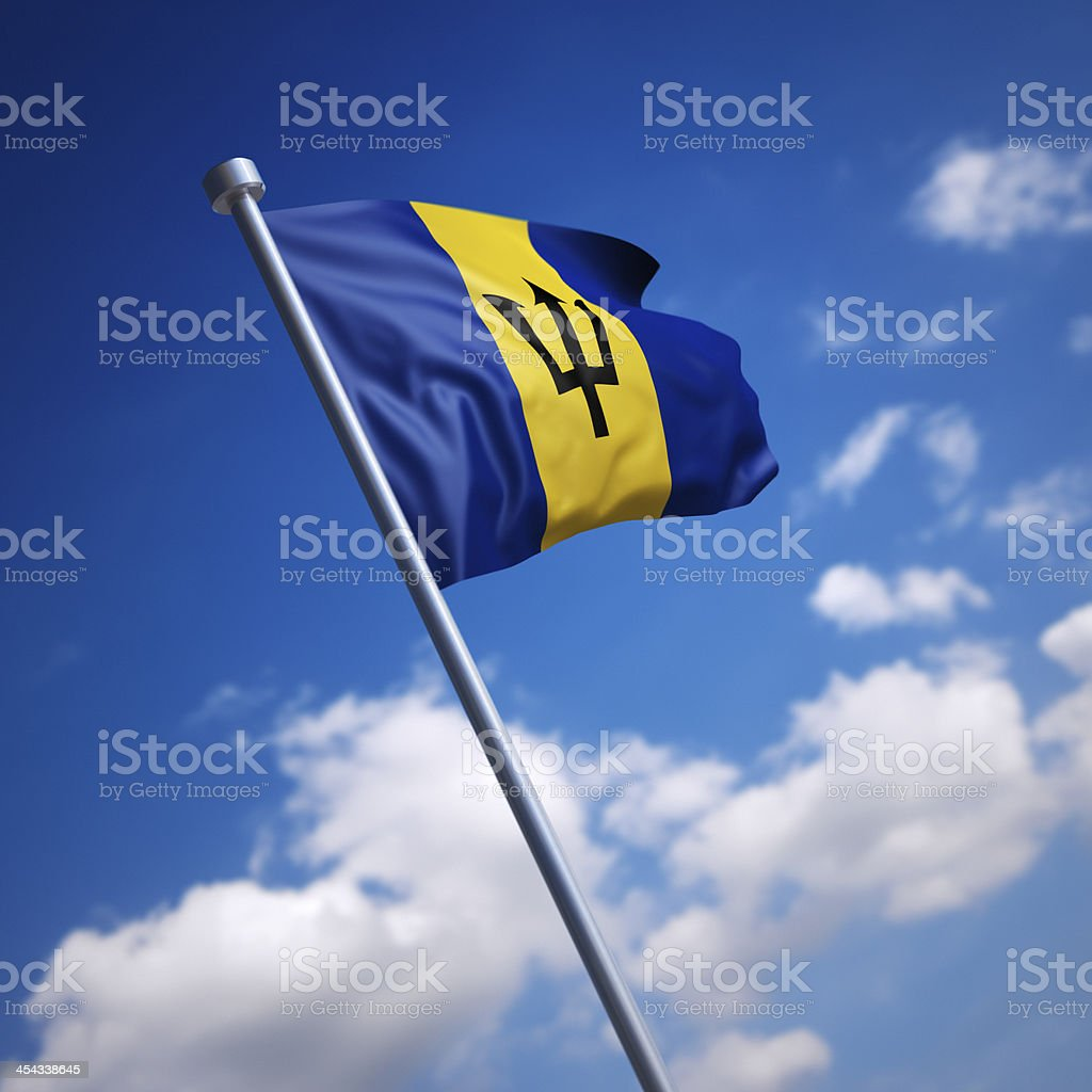 Flag of Barbados against blue sky stock photo