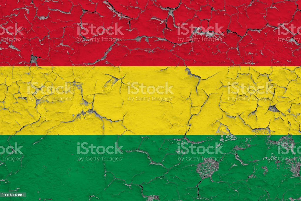 Flag of Bolivia painted on cracked dirty wall. National pattern on vintage style surface. stock photo