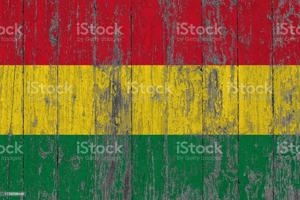 Flag of Bolivia painted on worn out wooden texture background. stock photo