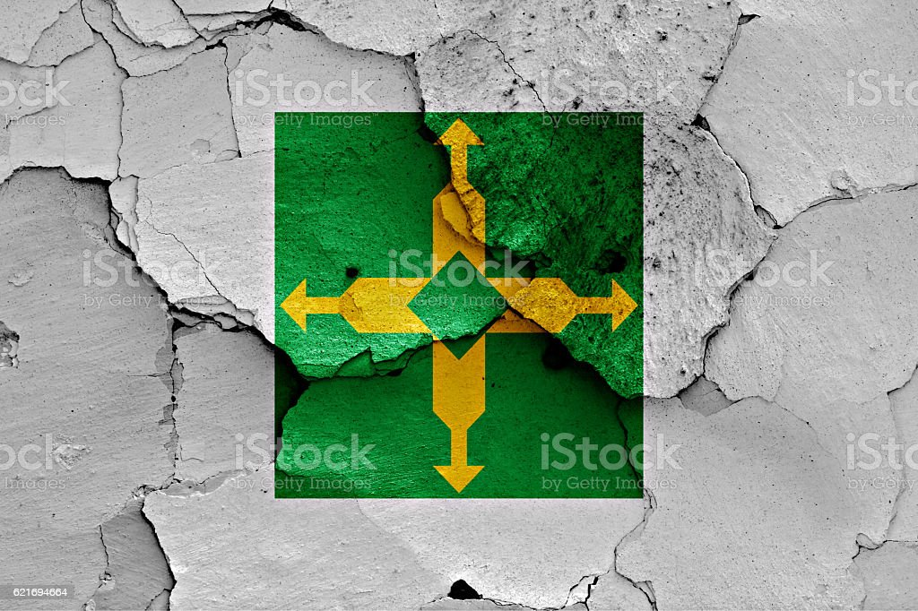 flag of Brasilia painted on cracked wall stock photo