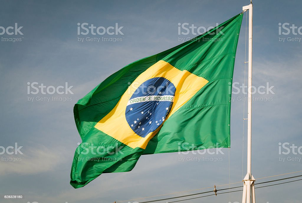 Flag of Brazil hoisted. Brazilian flag waving with the wind. stock photo