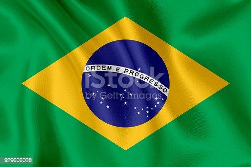istock Flag of Brazil waving background 929606028