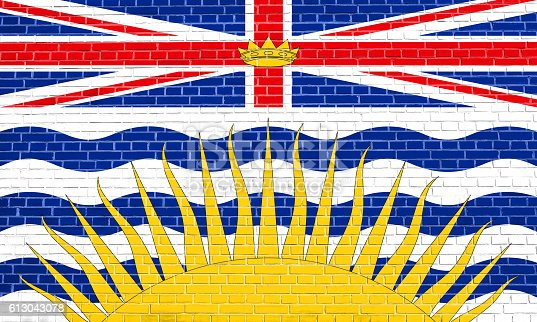 istock Flag of British Columbia on brick wall texture 613043078