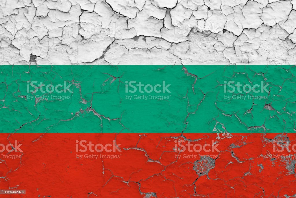 Flag of Bulgaria painted on cracked dirty wall. National pattern on vintage style surface. stock photo