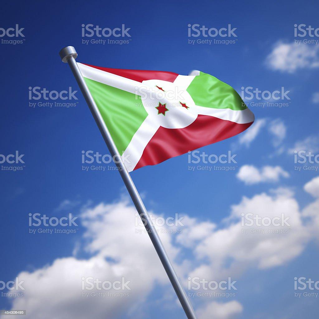 Flag of Burundi against blue sky stock photo