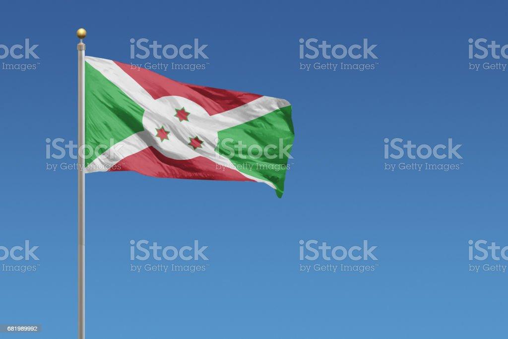 Flag of Burundi on a clear blue sky stock photo