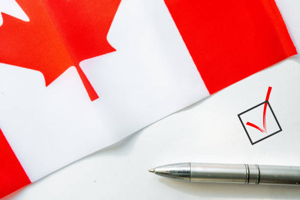 Flag of Canada and check mark stock photo