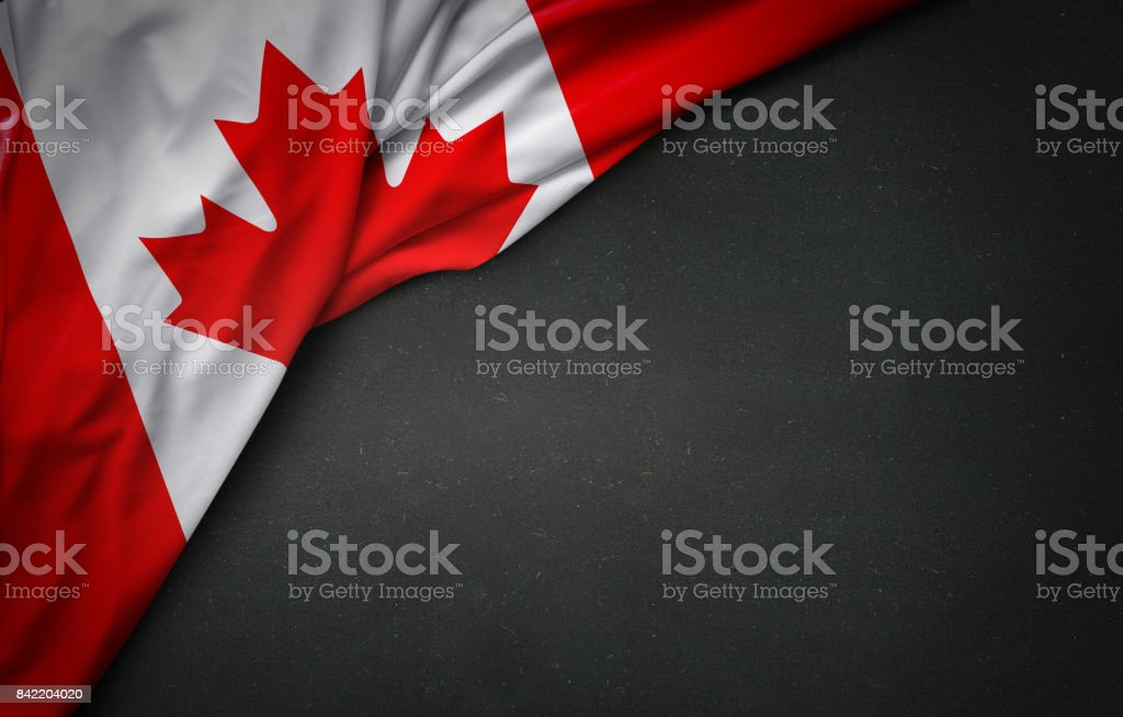 flag of Canada on blackboard stock photo