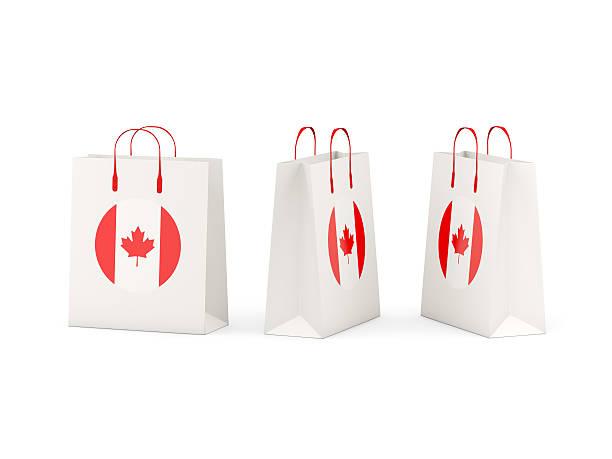 flag of canada on shopping bags - kanada rundreise stock-fotos und bilder