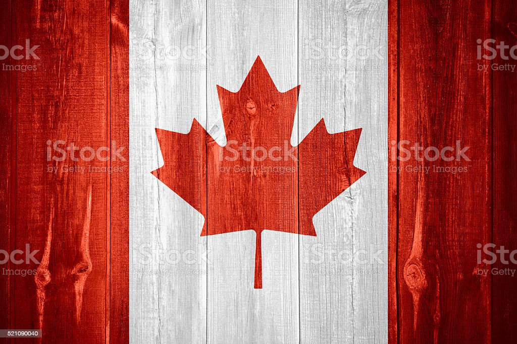 flag of Canada flag of Canada or Canadian banner on wooden background Backgrounds Stock Photo