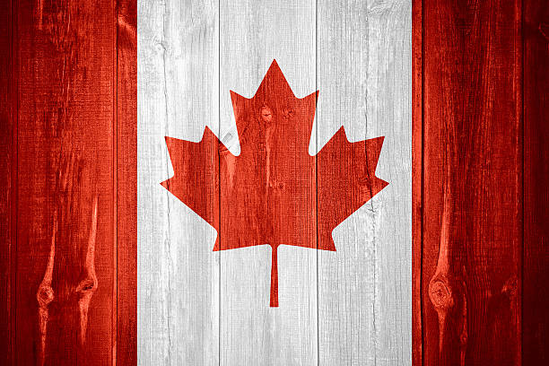 flag of Canada flag of Canada or Canadian banner on wooden background canada flag photos stock pictures, royalty-free photos & images