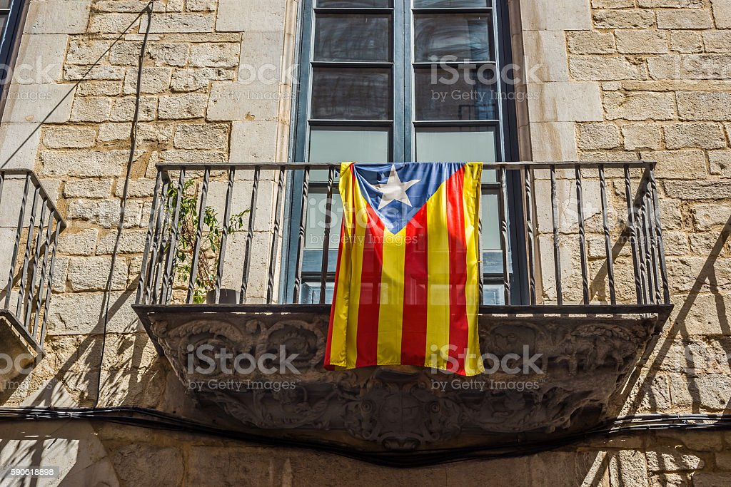Flag of Catalonia in the downtown of Girona. Spain. stock photo