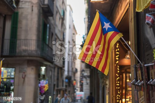 Flag of Catalonia on background of the street.