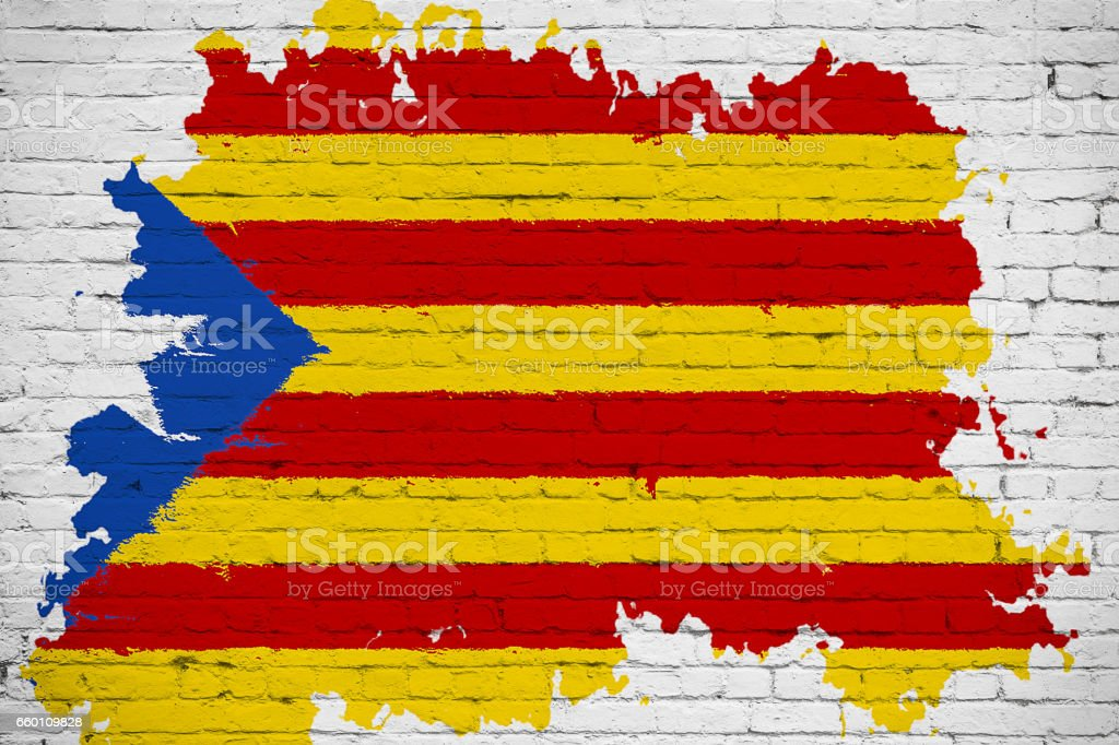 flag of catalonia yellow, red stripe and star with watercolor splash effect on white brick wall background, national catalan symbol vote for separatism independence from spain stock photo