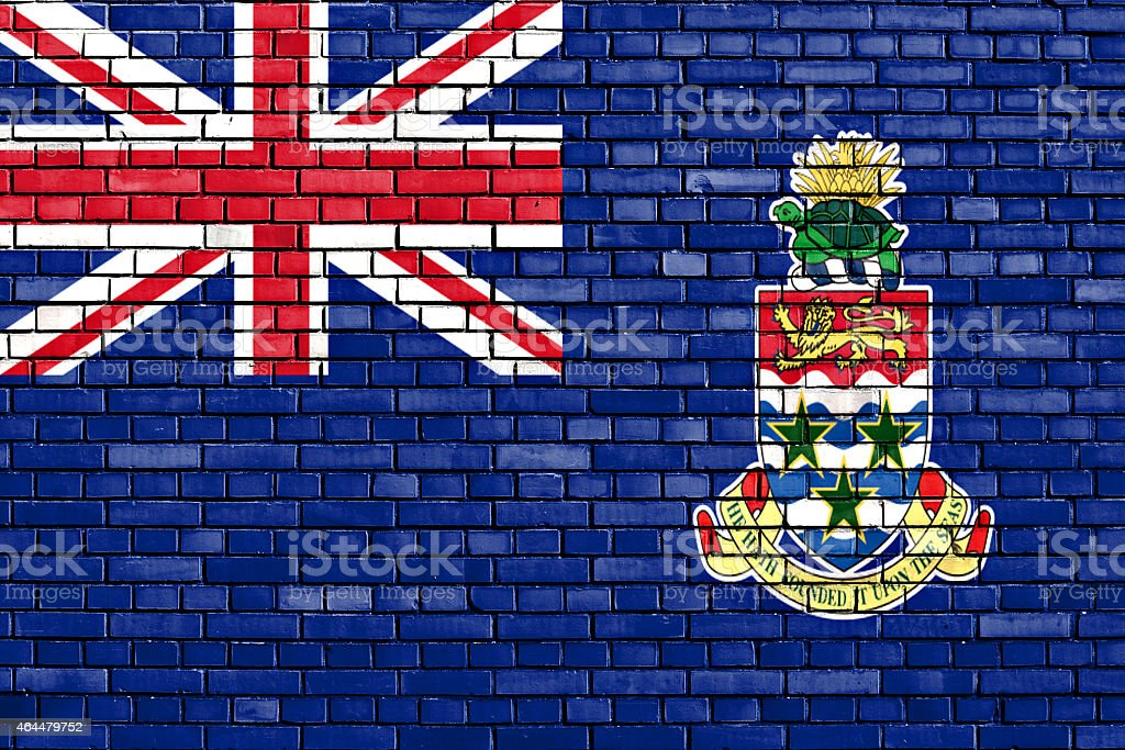flag of Cayman Islands painted on brick wall stock photo