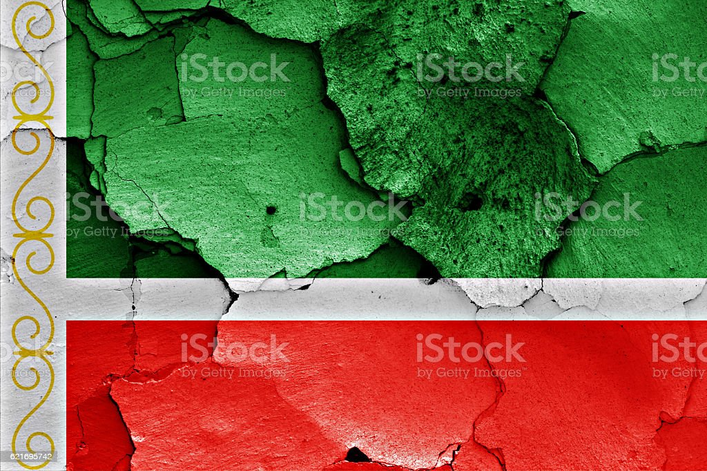 flag of Chechnya painted on cracked wall stock photo