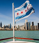 Chicago flag and the skyline from Lake Michigan.