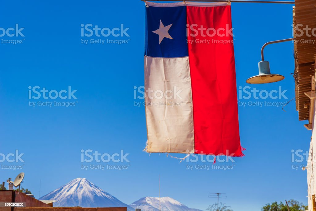 Flag of Chile and volcano Licancabur by San pedro de Atacama stock photo