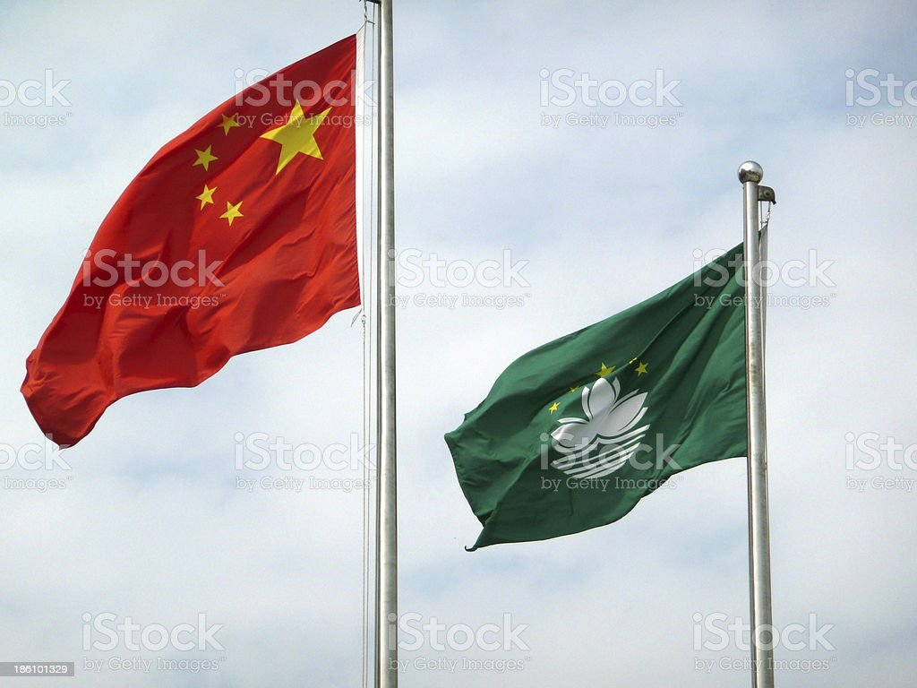 Flag of China and Macau blowing in the wind stock photo
