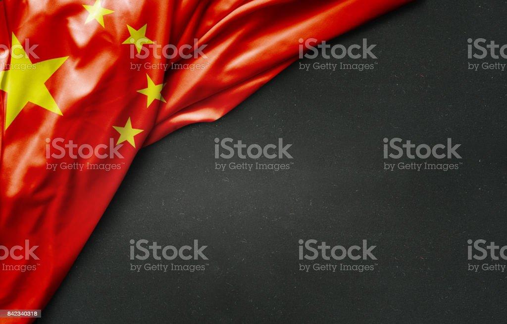 flag of China on blackboard stock photo