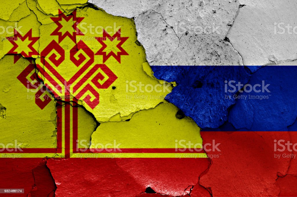 flag of Chuvashia and Russia painted on cracked wall stock photo