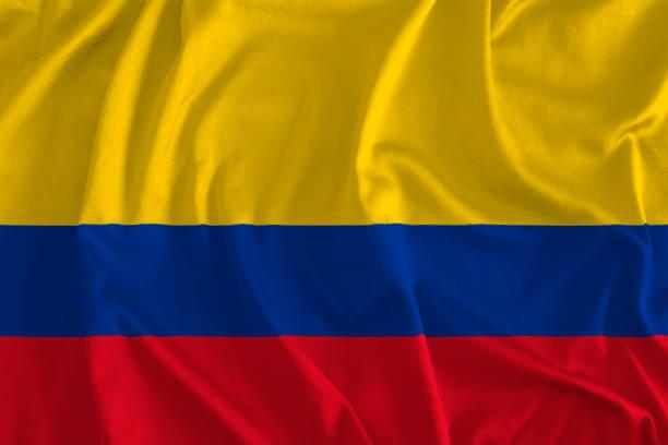 bandera de fondo colombia - bandera colombiana fotografías e imágenes de stock