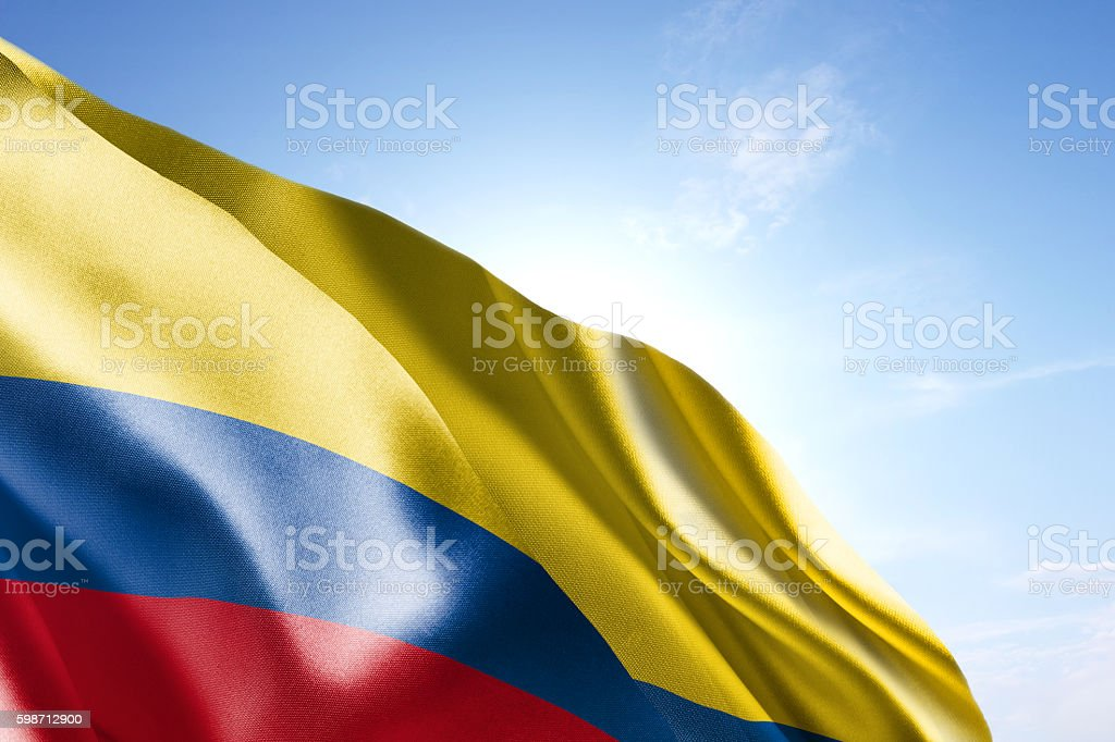 Bandera de Colombia saludar con la mano en el viento - foto de stock