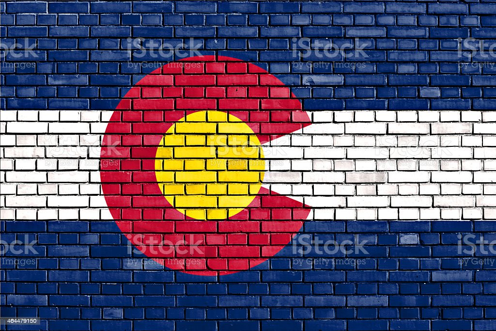 flag of Colorado painted on brick wall stock photo