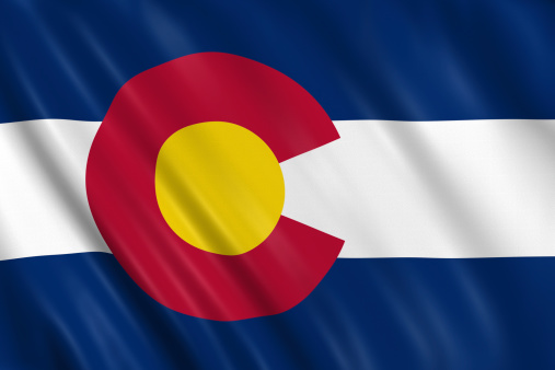 flag of colorado waving with highly detailed textile texture pattern