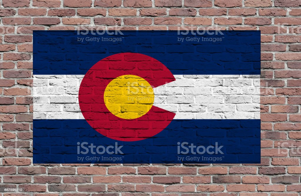 Flag of Colorado State painted over brick wall stock photo