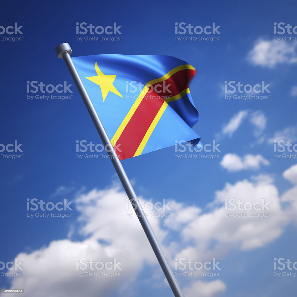 Flag of Congo, Democratic Republic (Zaire) - against blue sky stock photo