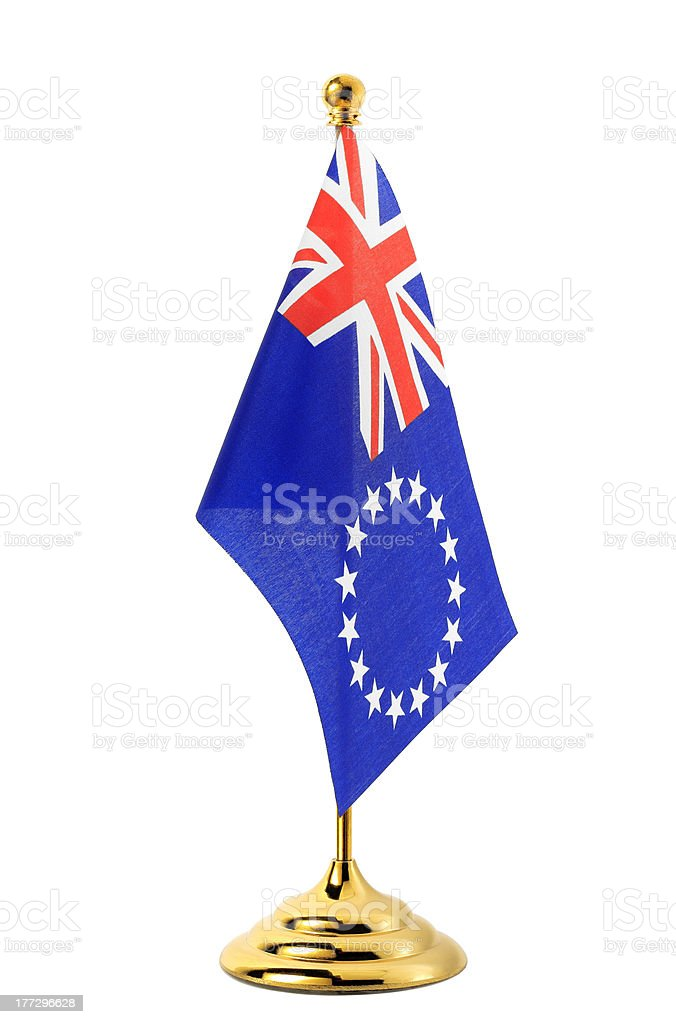 Flag of Cook Islands hanging on the gold flagpole royalty-free stock photo