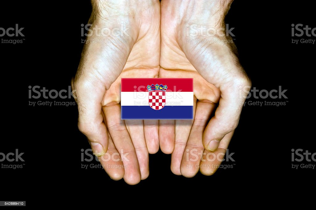 Flag of Croatia in hands on black background stock photo