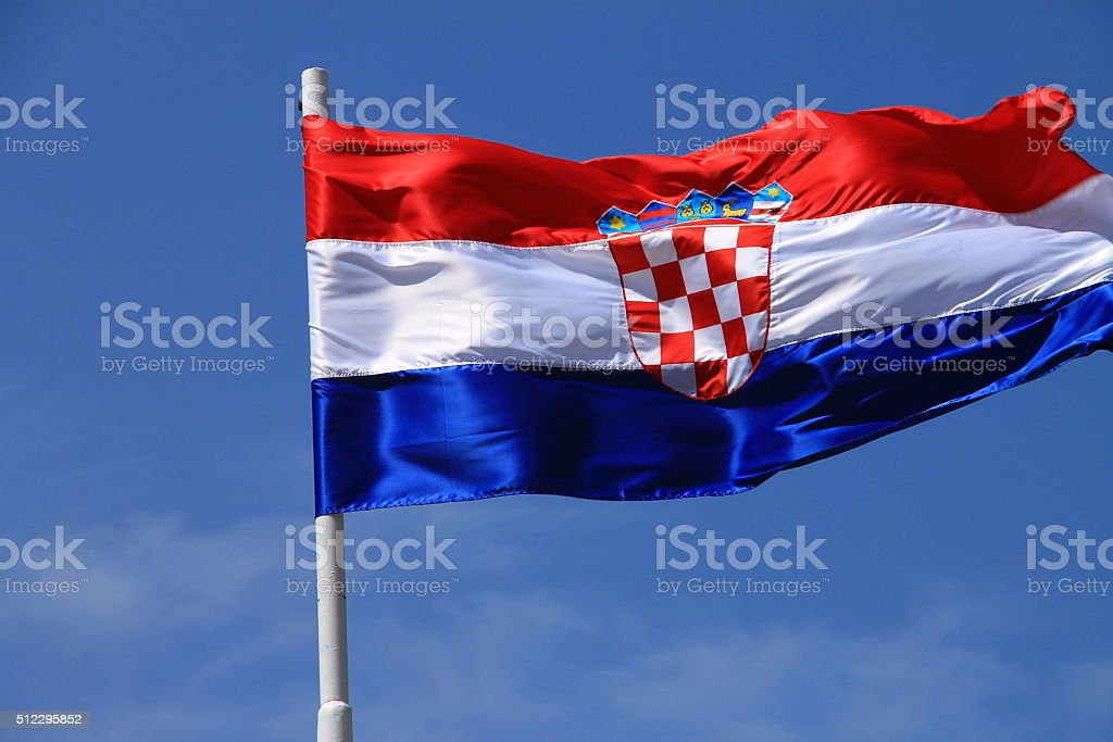 Flag of Croatia with flag pole waving in the wind stock photo