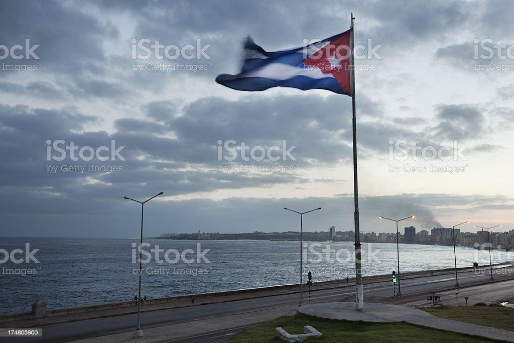 Flag of Cuba along Sea Wall at Malecón Skyline, Havana royalty-free stock photo