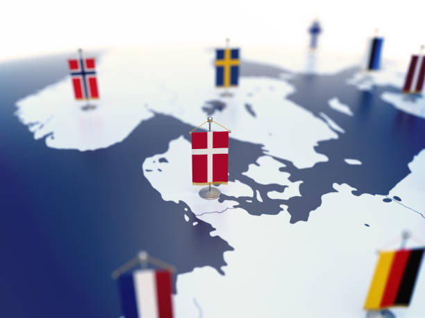 Flag of Denmark in focus among other European countries flags stock photo